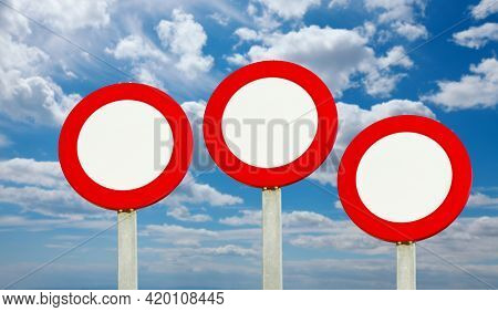 Speed limit traffic signs left blank, you can add any number, or use as no entry sign three posts agains sunny cloudy sky