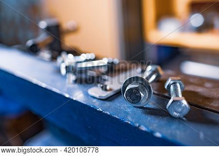 Metal Chrome Bolts And Nuts On Manual Flexible Massive Machine