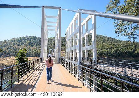 Tourist Woman With An Iconic White Bridge In Mae Kuang Dam, Chiang Mai Province Of Thailand. Mae Kua