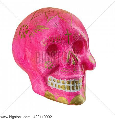 Typical Mexican skull painted isolated on white background. Dia de los muertos. Creative and minimal Day of the Dead or Halloween layout. Skull pink