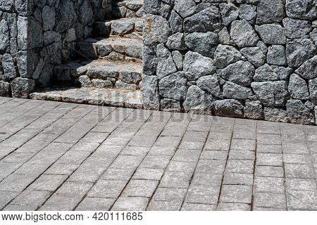 Gray Granite Stone Wall And Granite Staircase In The Park.