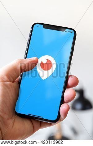 Paris - France - March 23, 2021 : Hand Holding Iphone Smartphone With Periscope Logo