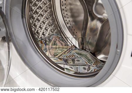 Money, Dollars Washing And Laundering In Washing Machine, Closeup View.
