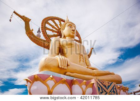 Golden statue of Buddha sitting with beautiful skies above poster