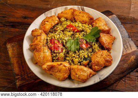 Food For Suhoor In Ramadan Bulgur Post With Beef In A Plate On A Wooden Table. Horizontal Photo