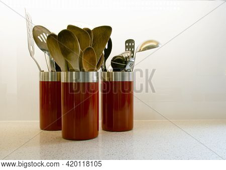 Side View Of A Set Of Kitchen Utensil Holders With Utensils