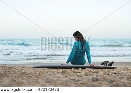 Surfer Girl Walking With Board On The Sandy Beach. Surfer Female.beautiful Young Woman At The Beach.