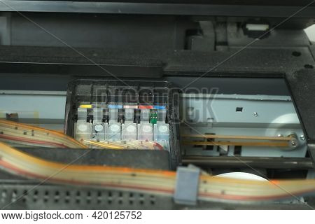 Continuous Ink Supply System Is Working In Printer Moving Inside, Closeup View. Preparing New Inkjet