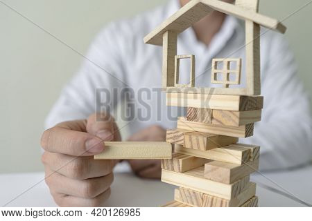Bank Worker Plug In Wooden Blocks With Model House. Copy Space On Wooden Blocks Or Entering Text. Co