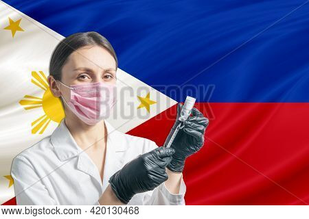 Girl Doctor Prepares Vaccination Against The Background Of The Philippines Flag. Vaccination Concept