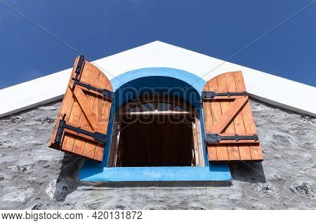 Window With Open Wooden Shutters In Blue Frame. Rural Architecture Of Madeira Island, Portugal