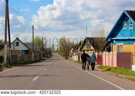 Belarusian Landscape, Summer Road Through The Village, With Wooden Houses And Large Trees, Village L