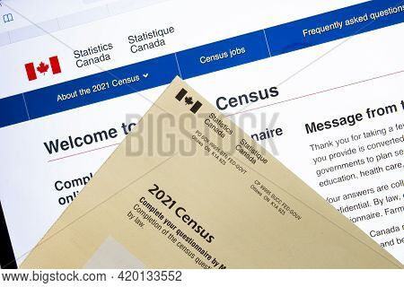 Calgary, Alberta, Canada. May 11, 2021. An Online Census Questionnaire And Paper Mail.