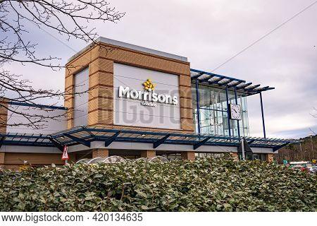 Swansea, Wales, Uk - February 7, 2021: Logo Of Morrisons Supermarket In Morfa Shopping Park In Swans