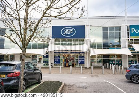 Swansea, Wales, Uk - February 7, 2021: Entrance And Car Park Of Boots Retail Outlet In Morfa Shoppin