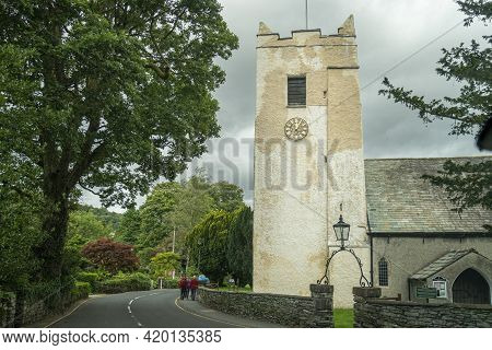 Grasmere, Cumbria, Uk, August 2020 - Saint Oswald's Church Tower In The Village Of Grasmere In The L