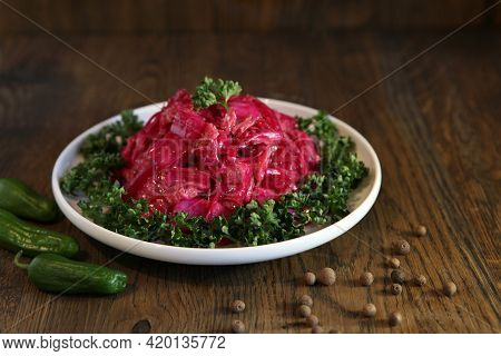 Korean Cabbage Salad With Beets On A Plate With Pepper. Delicious Asian Cusine