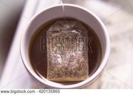 White Cup With Infusion And Tea Bag. No People