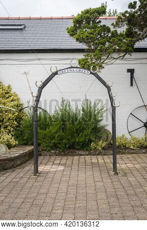 Arch Of Horseshoes At The Blacksmiths Shop Wedding Venue In The Village Of Gretna Green, Scotland, U