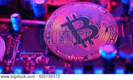 Cryptocurrency Coins On Circuit Board. Bitcoins Standing On Cpu Board.