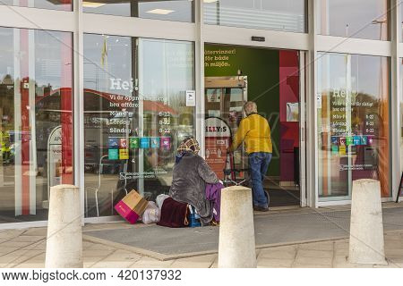 Close Up View Of Beggar At Entrance To Supermarket. Uppsala. Sweden. 05.12.2021.