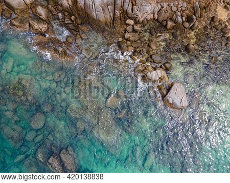 Aerial View Of Turquoise Ocean Wave Reaching The Coastline. Beautiful Tropical Coastal Landscape Fro