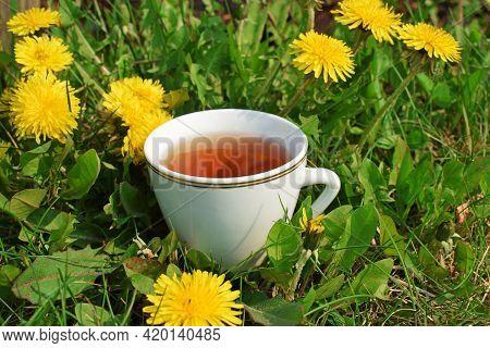 Dandelion Tea.healthy Drink.alternative Medicine.medicinal Drink.dandelion On The Lawn.