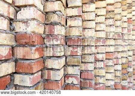 Background Of Masonry Of Ceramic Bricks Wall On Cement Mortar