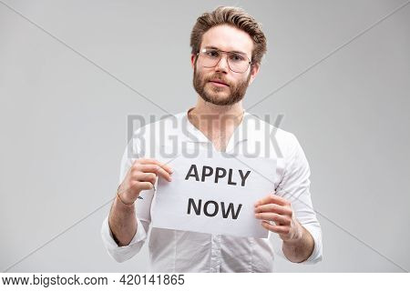 Studio Shot Portrait Of A Man Working As A Recruiter In Human Resources Or A Manager Showing A Paper