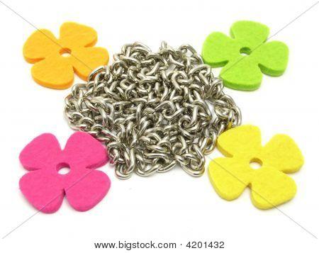 Flowers Of Felt Fraiming A Chain