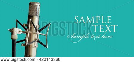 Professional Studio Vocal Microphone. Isolated On A Green Background