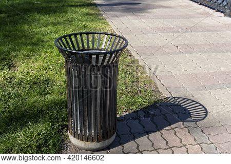Public Rubbish Bin In A Park - Switzerland. Empty Trash Can In The Park