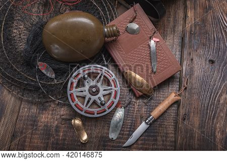 Vintage Fishing Still Life. Fishing Things On The Table. Knife And Tackle On The Table.