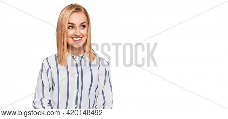 Beautiful caucasian woman wearing casual clothes smiling looking to the side and staring away thinking.
