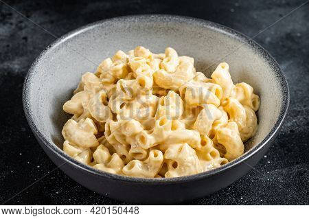 Mac And Cheese American Macaroni Pasta With Cheesy Cheddar Sauce. Black Background. Top View