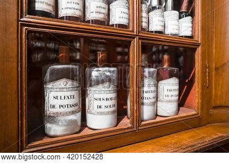 Beaune, France - August 03,2019: Shelf With Medicines In Glass Bottles In A Retro Pharmacy