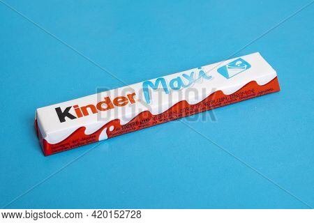 Belarus, Novopolotsk - 11 May, 2021: Kinder Maxi On Blue Background Close Up
