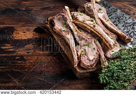 Grilled Mutton Chops Steaks On Butcher Board With Meat Cleaver. Dark Wooden Background. Top View. Co