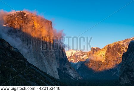 Winter Sunset Shot Of Yosemites El Capitan And Half Dome As Storm Clouds Clear From Yosemite Nationa