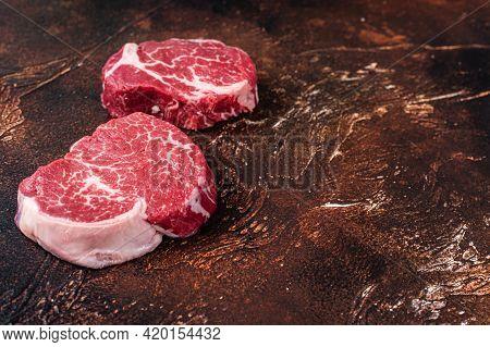 Raw Fillet Mignon Tenderloin Steaks. Dark Background. Top View. Copy Space