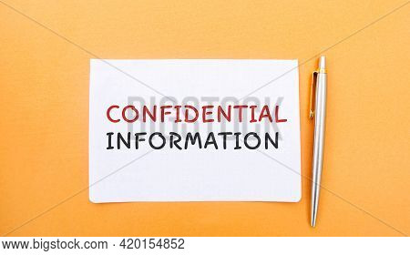 Notes With The Inscription Confidential Information And A Pen. Non-public Oral Or Written Business I