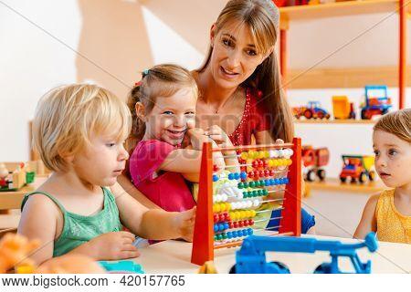 Preschool teacher playing with the children
