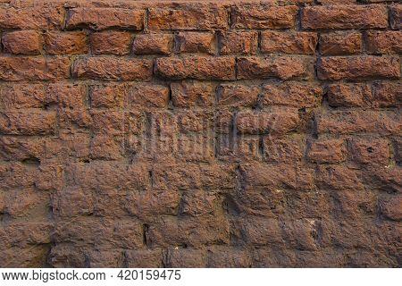 Old Weather-beaten Grunge Red Brick Wall Background