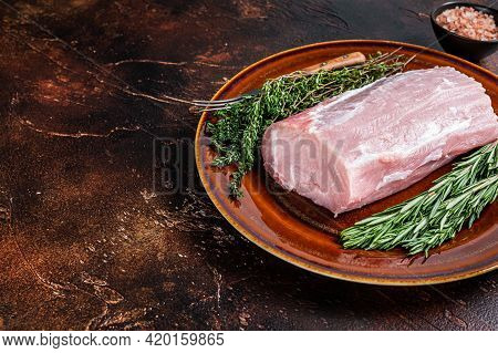 Fresh Raw Pork Loin Meat With Thyme And Rosemary On Rustic Plate. Dark Background. Top View. Copy Sp