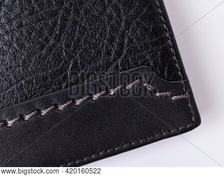 Сlose-up Of Black Grainy And Smooth Leather With Decorative Grey Stitching