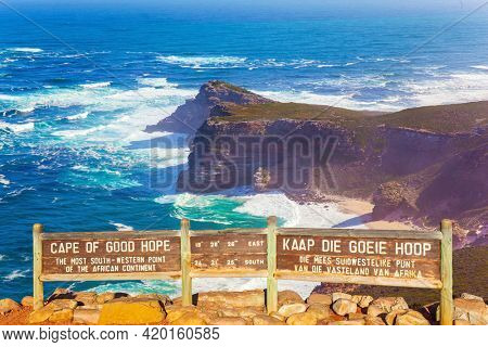 Bird's-eye view. Cape of Good Hope at the southern tip of the Cape Peninsula, South Africa. White foam of the ocean surf. Powerful ocean surf. Bright sunny summer February day.