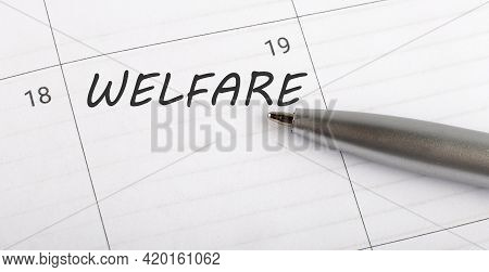 Text Welfare On Calendar Planner To Remind You An Important Appointment With Pen On Isolated White B
