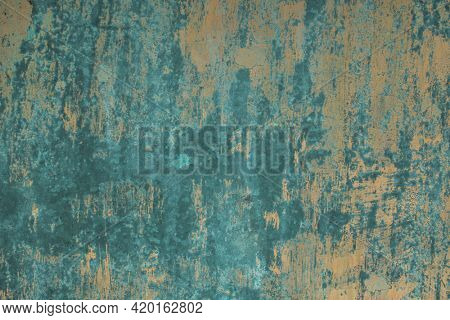 The texture of a worn metal surface with traces of old paint.