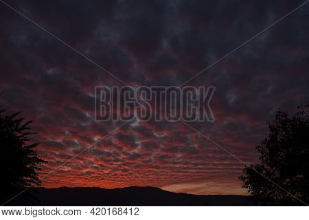 Picture Of Dark Pink Blue Clouds And Mountain In Evening. Himachal Pradesh India