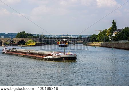 Koblenz, Germany - July 07, 2018: Carriage Of Goods By Barges Along The Moselle River In Koblenz